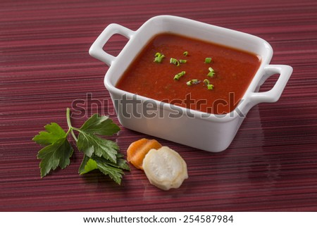 tomato soup on the plate with fresh vegetables decorated for menu card - stock photo