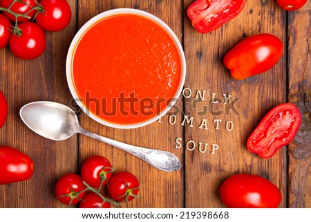 Tomato soup on the table - stock photo
