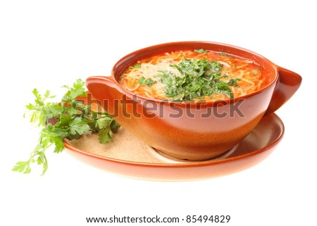 Tomato soup parsley isolated against a white background - stock photo