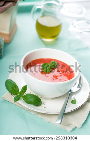 Tomato soup, served with Fresh Basil and Spice