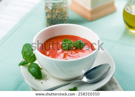 Tomato soup, served with Fresh Basil and Spice - stock photo