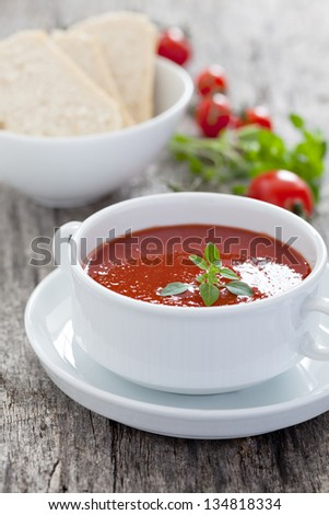 tomato soup with basil - stock photo