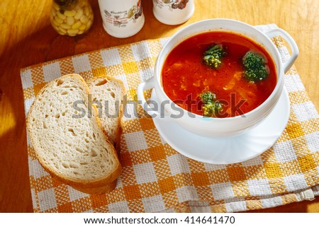 Tomato soup with bread. - stock photo