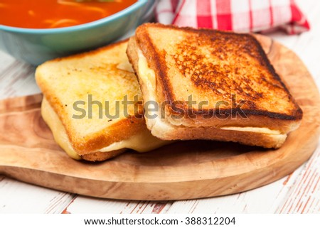 Tomato soup with cheese sandwich - stock photo