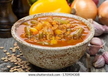 tomato soup with lentils and vegetables, close-up - stock photo