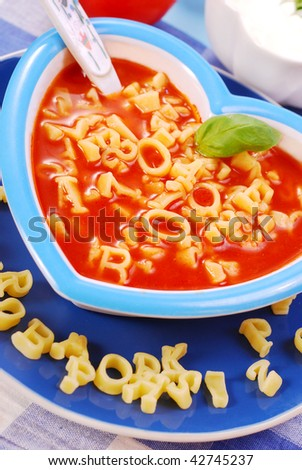 tomato soup with  pasta in the shape of letters  for child - stock photo