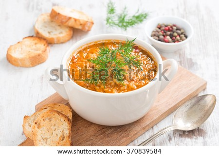 tomato soup with rice, vegetables and bread, close-up - stock photo