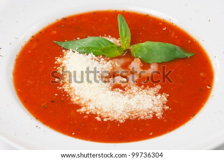 tomato soup with shrimp and parmesan cheese - stock photo