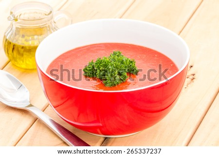 tomato soup with spoon on kitchen table
