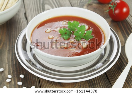 Tomato soup with white beans. Vegetarian dish