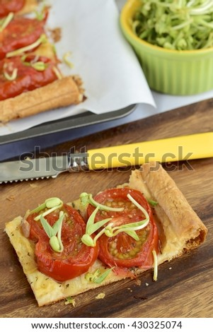 Tomato tart puff pastry topped with bean sprouts