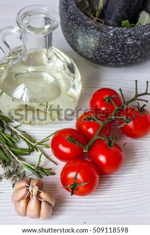 tomato with olive oil on wooden background