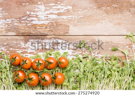 Tomato with Pea Sprout and Banana spice on wood top - stock photo