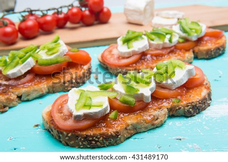 Tomatoe sandwich with tomato marmalade and fresh cheese and basil - stock photo
