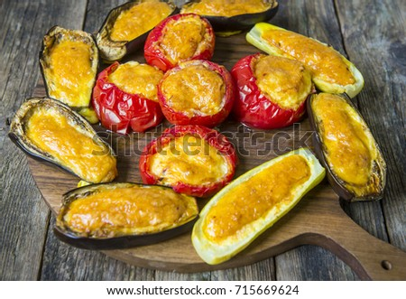 Tomatoes and aubergines baked in the oven with cheese