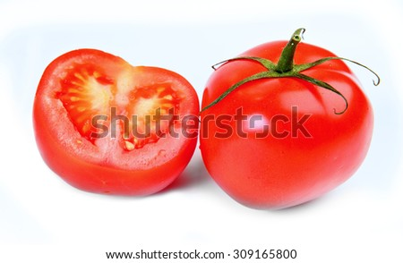 Tomatoes and cross  isolated on white - stock photo