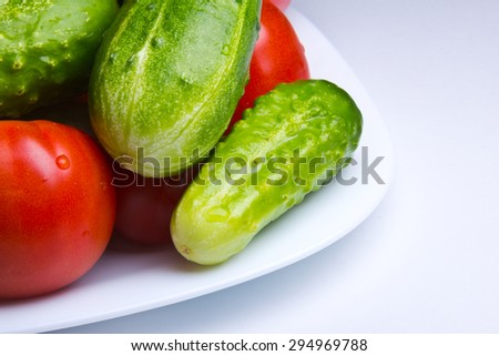 Tomatoes and cucumbers.