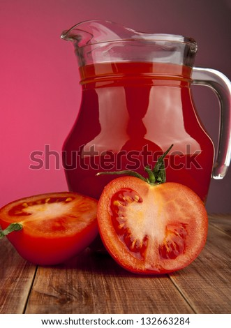 tomatoes and juice on a red background