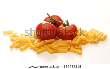 Tomatoes and macaroni isolated on white background