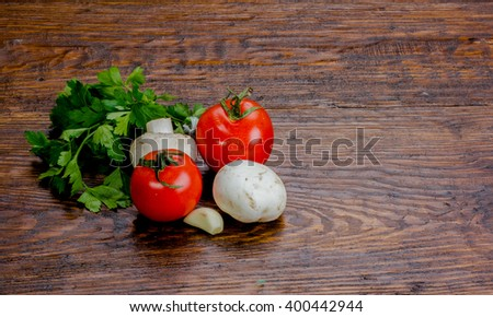 tomatoes and mushrooms on a wooden table