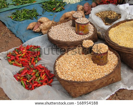 Tomatoes and other vegetables for sale in weekly market  in Ankadeli, Orissa in India