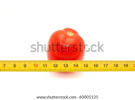 Tomatoes and ruler on a white background