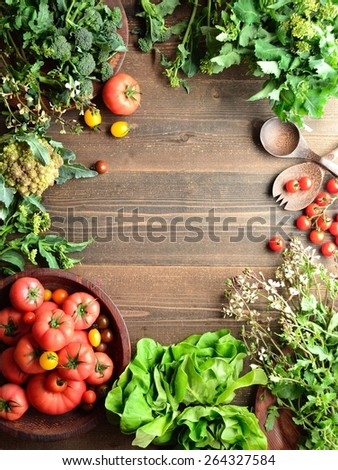 Tomatoes and spring green vegetables - stock photo