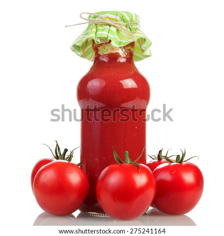 Tomatoes and Tomato juice in glass jar on white background - stock photo