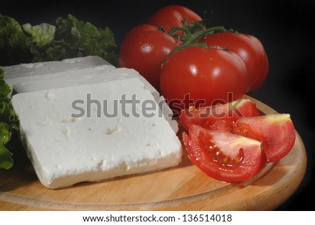 tomatoes and white greek cheese - stock photo