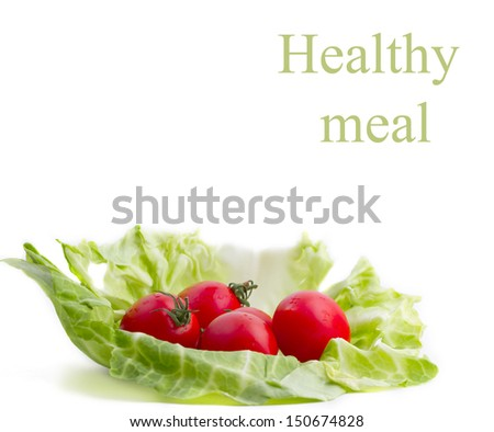 Tomatoes are on cabbage leaves. isolated