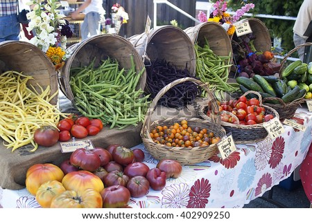 Tomatoes,beans,cucumbers, and beats for sale at a farmers market. - stock photo