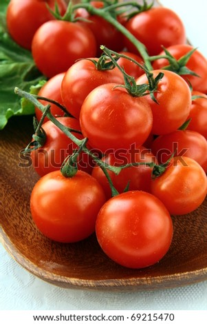 Tomatoes Cherry on  wooden board - stock photo