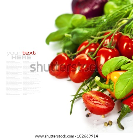 Tomatoes, chives, peppers, herbs, onions and cucumbers over white - stock photo