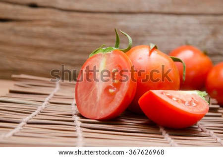 Tomatoes, cooked with herbs for the preservation on the old wooden background