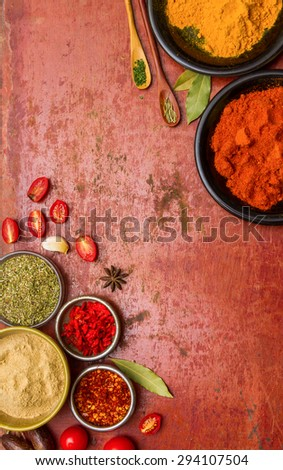 Tomatoes, cooked with herbs on the old wooden background. - stock photo