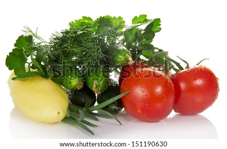 Tomatoes, cucumbers, pepper, parsley, dill and the onions isolated on white