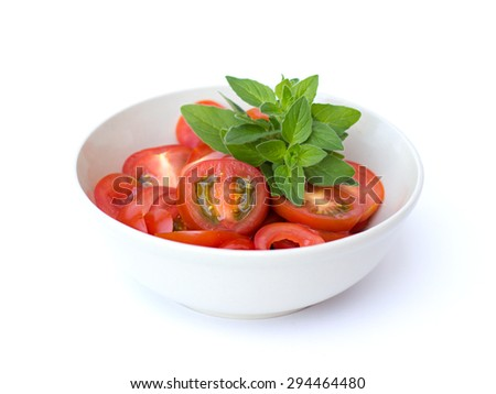 tomatoes in a bowl on a white background - stock photo