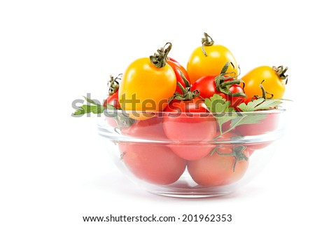 Tomatoes in a glass isolated on a white background.