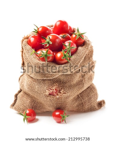 Tomatoes in canvas bag isolated on white background - stock photo