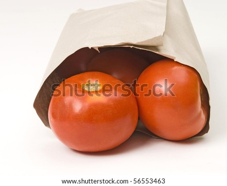 tomatoes in paper bag - stock photo