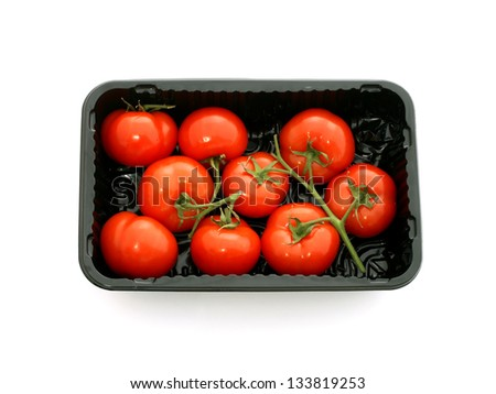 Tomatoes in plastic packing isolated on white background