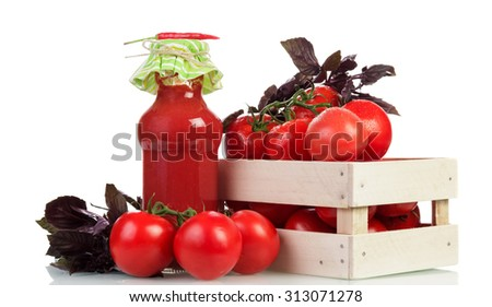 Tomatoes in wooden crate and Tomato juice on white background - stock photo