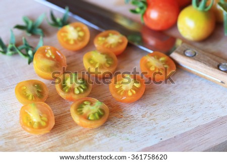 Tomatoes on a kitchen cutting board - stock photo