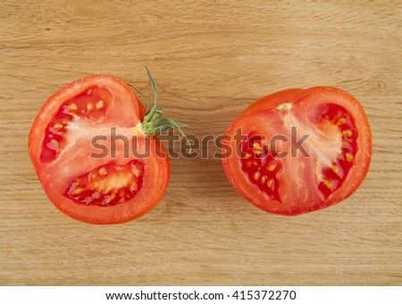 tomatoes on a wooden background - stock photo