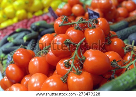 Tomatoes on display in a supermarket - stock photo