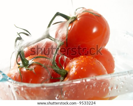 tomatoes on the dish and water fall - stock photo