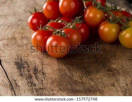Tomatoes on wood - stock photo
