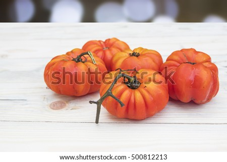 tomatoes on wood table