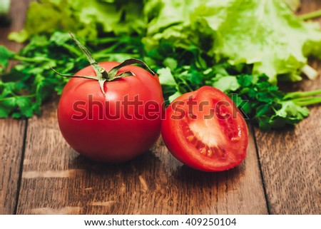 Tomatoes on wooden table - stock photo