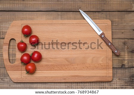 Tomatoes on wooden table. Recipe design horizontal. Top view